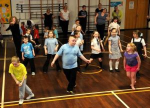 berryhill primary staff parents and kids get into the street dancing