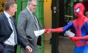 Spiderman hands out leaflets